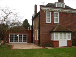 Single storey bay window extension with original windows above.