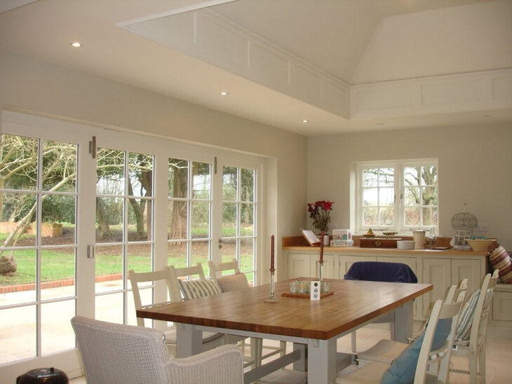 View of four leaf, bi-folding door set in kitchen extension.