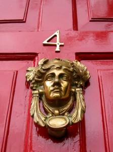 painted red front door brass knocker