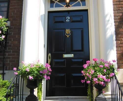 painted black front door with brass lion head knocker