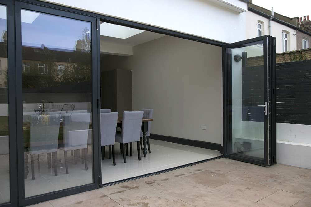 Replace partitions with bi-folding timber doors & Sussex Bifold Doors | Parsons Joinery