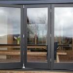 Exterior Bi folding doors painted black barn conversion