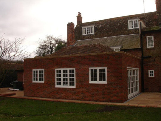 Side elevation of kitchen extension with replica dormer windows above.